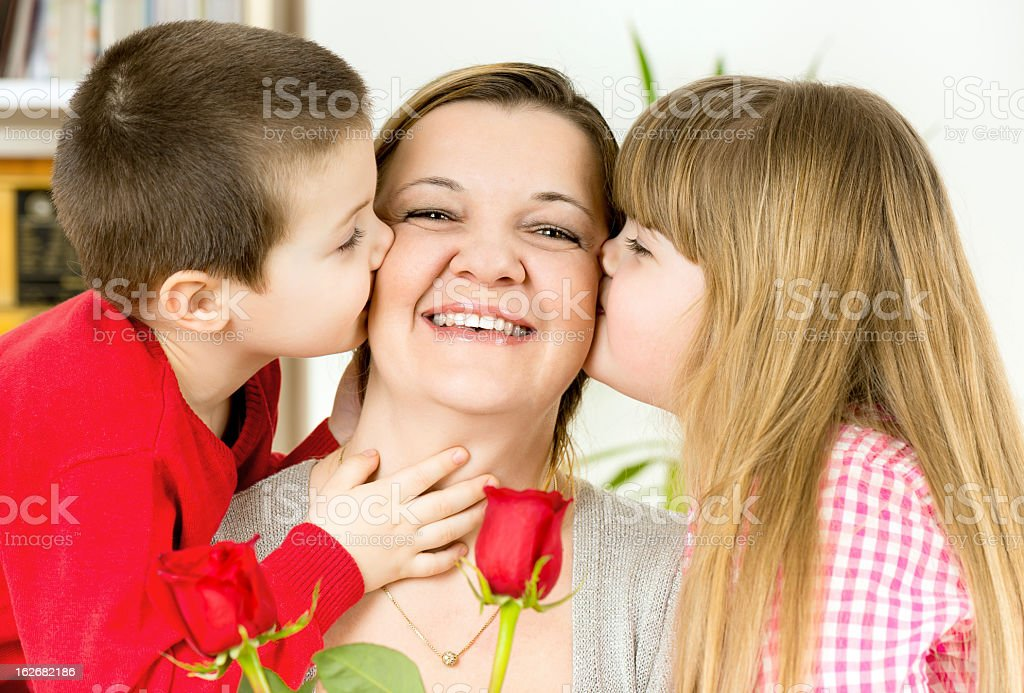 mother, daughter and son stock photo