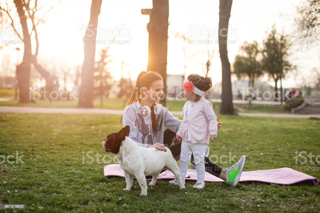 Mother , daughter and their pet French bulldog stock photo
