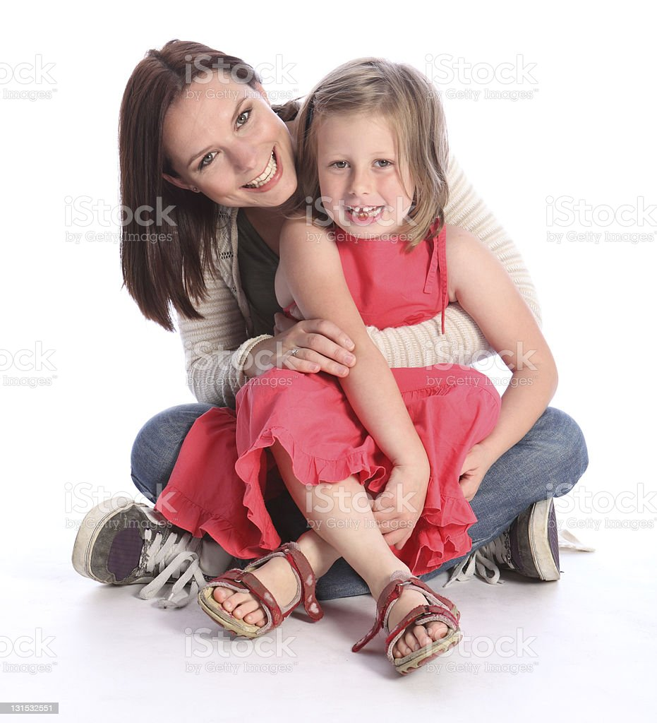 Mother daughter fun and laughter sitting on floor royalty-free stock photo