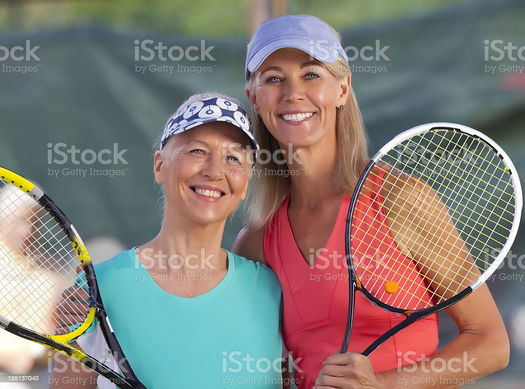 Mother daughter Tennis Partners royalty-free stock photo