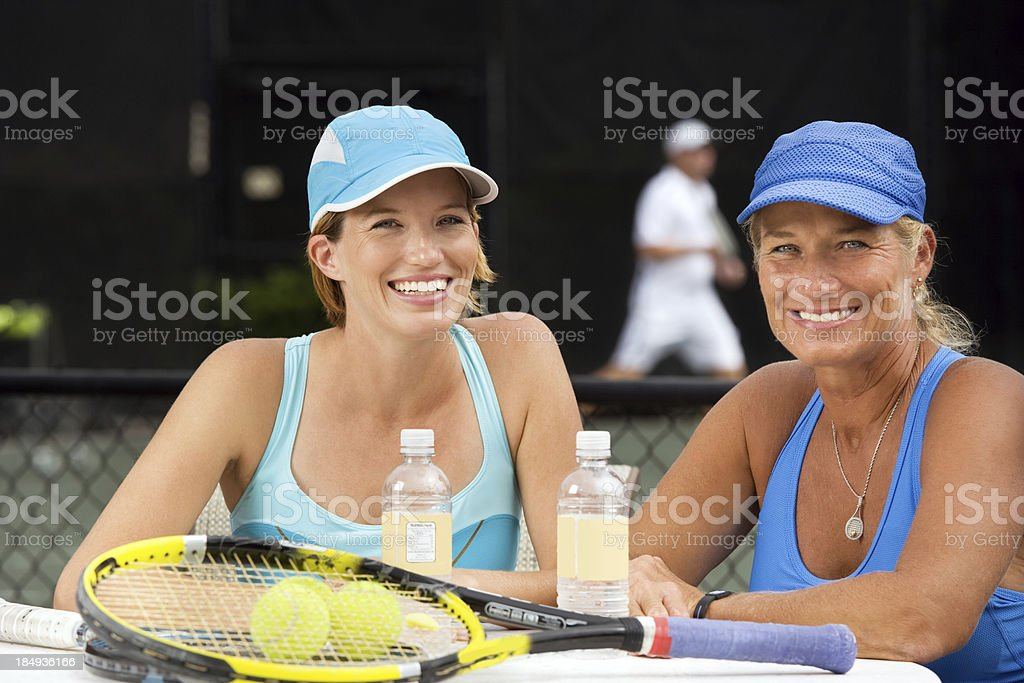 mother daughter tennis players doubles partners royalty-free stock photo