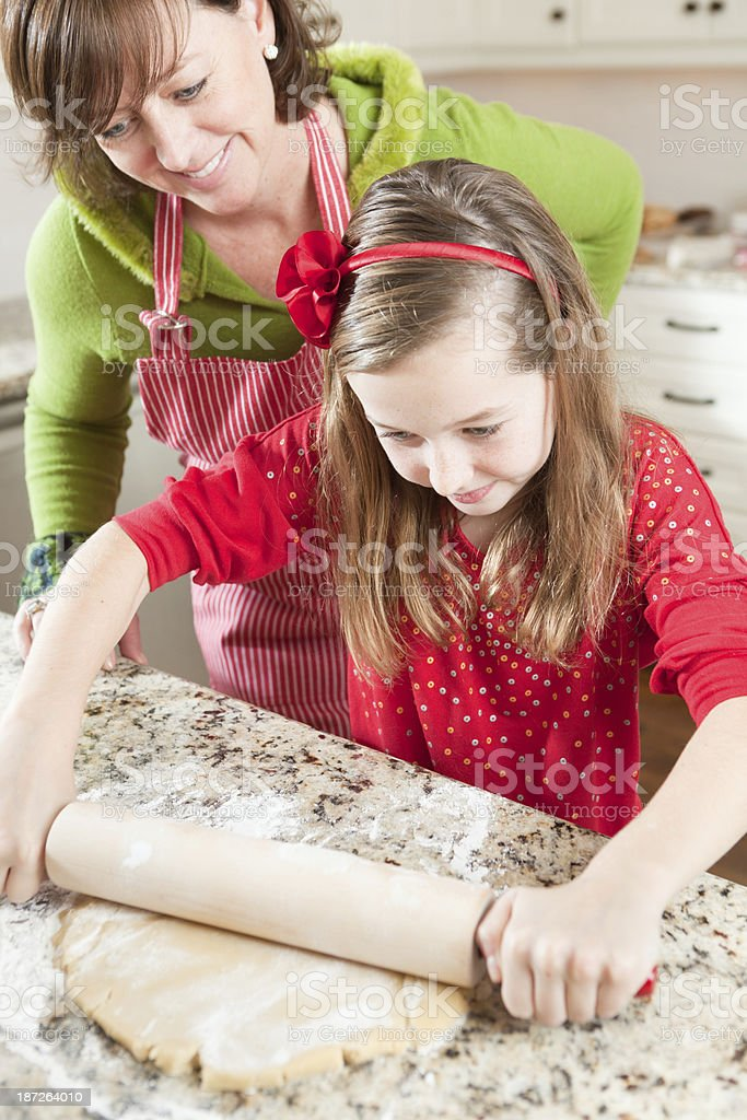 Mother Daugther Working in Kitchen with Dough For Baking Vt royalty-free stock photo