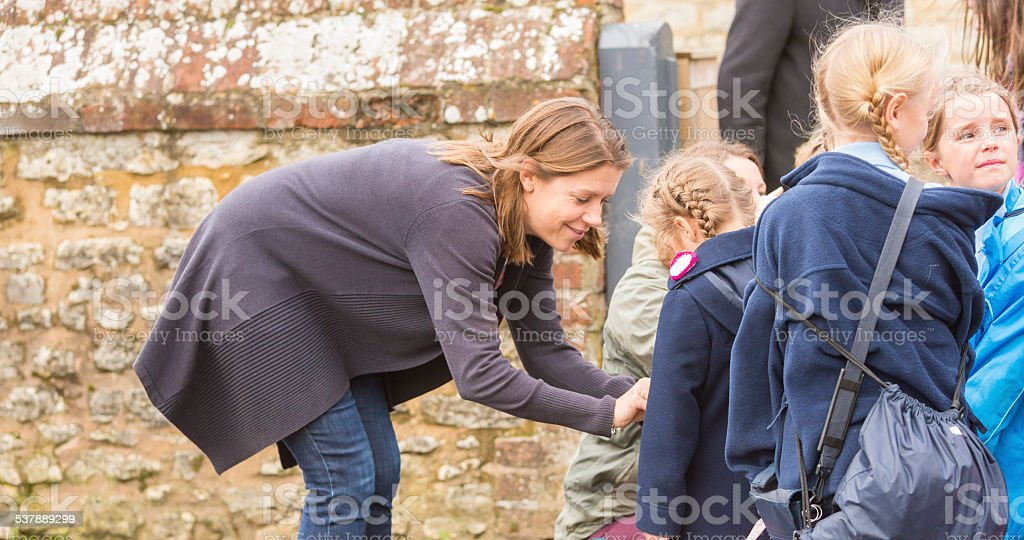 Mother Dropping Child to School stock photo
