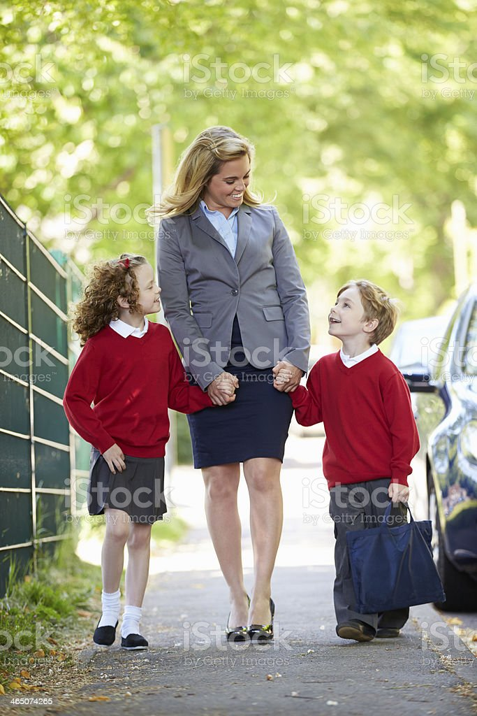 Mother Dropping Kids Of At School On Way To Work stock photo