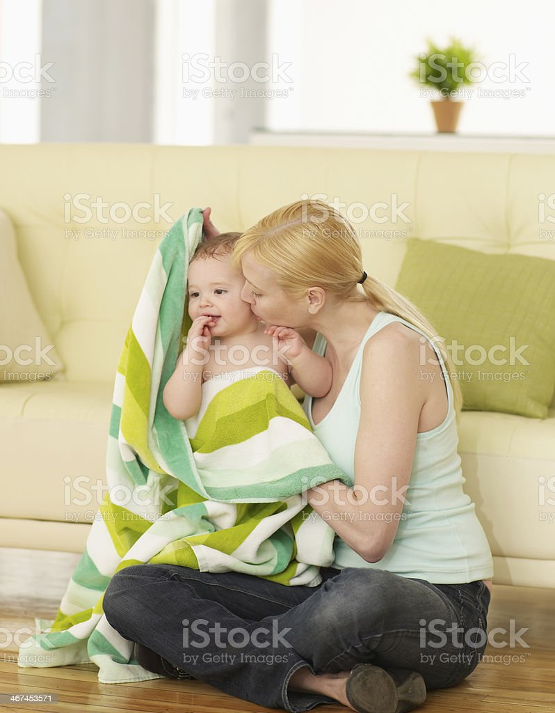 Mother Drying Baby Boy with Towel stock photo