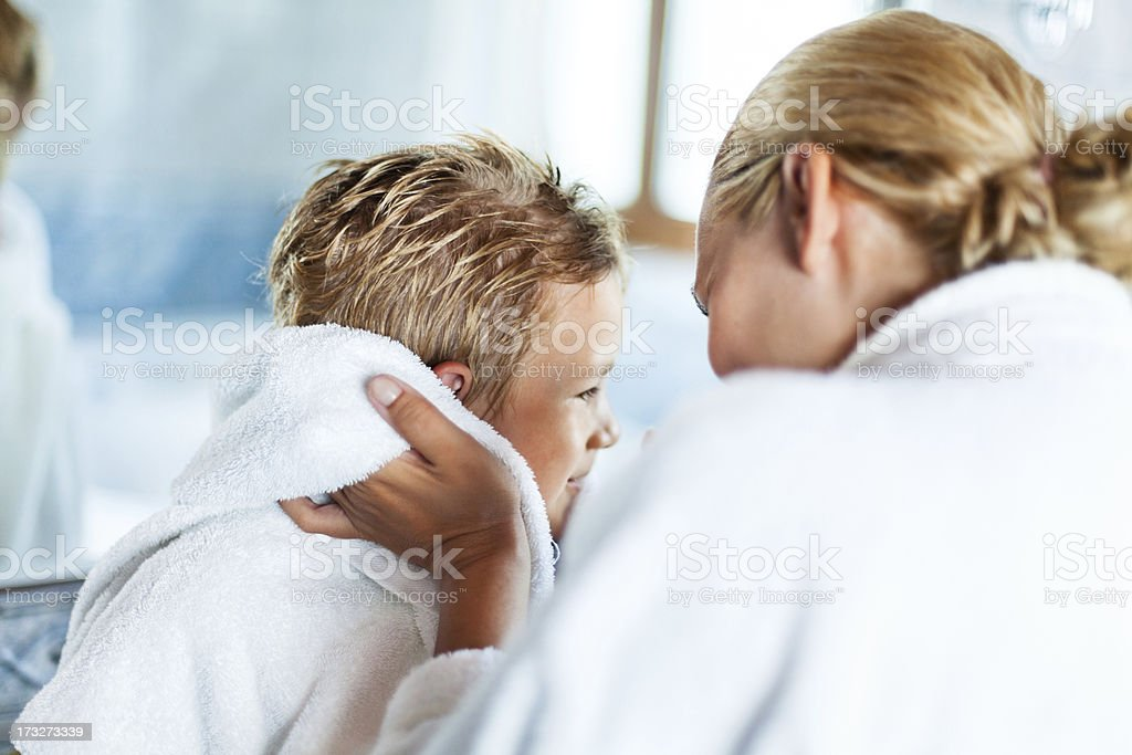 Mother drying up son after bath royalty-free stock photo