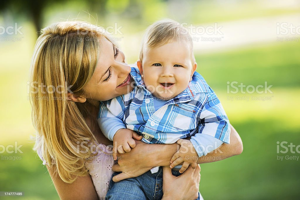 Mother embracing her beautiful son. royalty-free stock photo