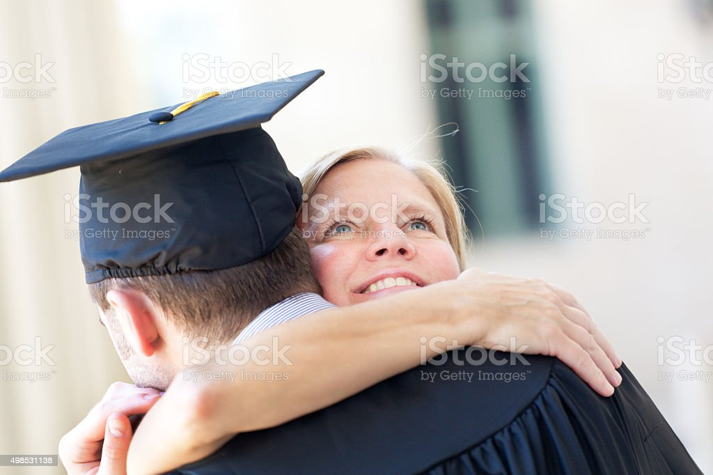 Mother Embrassing Graduating Son in Graduation Ceremony Horizontal stock photo