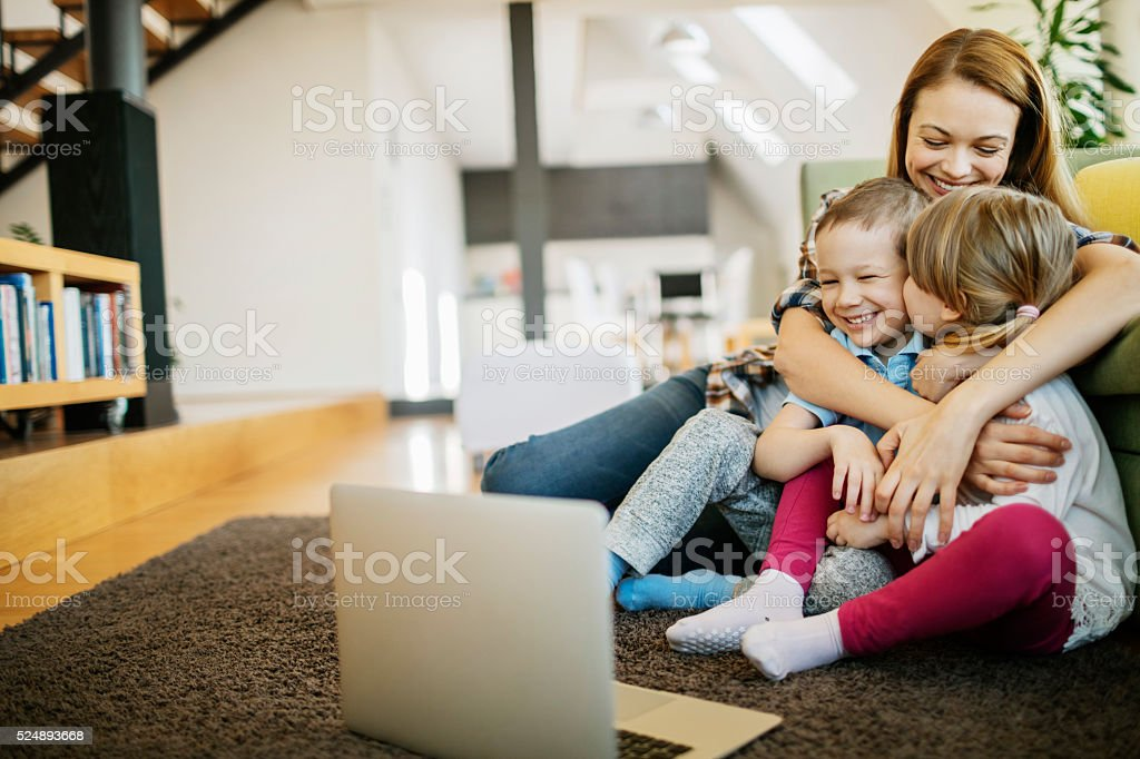 Mother enjoying time with kids stock photo
