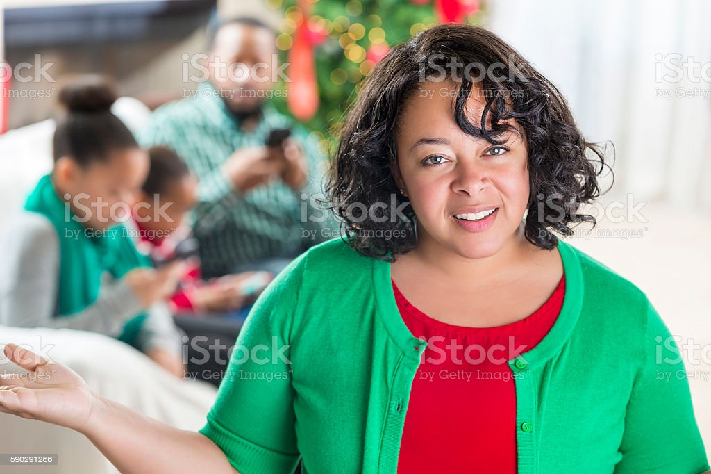 Mother expresses concern with family's use of technology at Christmatime stock photo