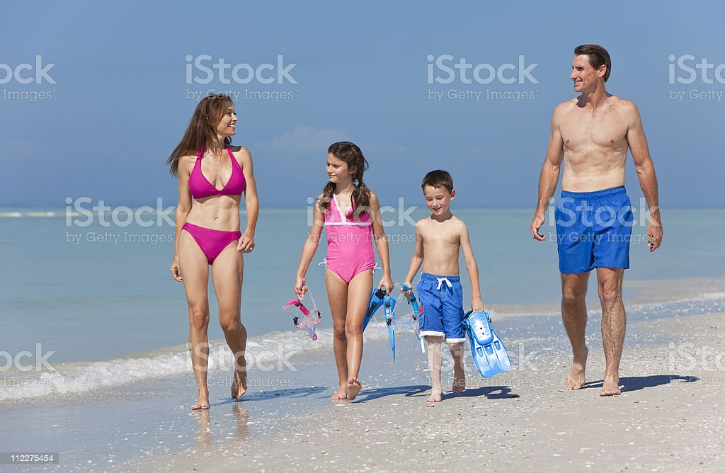 Mother, Father and Children Family Having Fun At Beach royalty-free stock photo