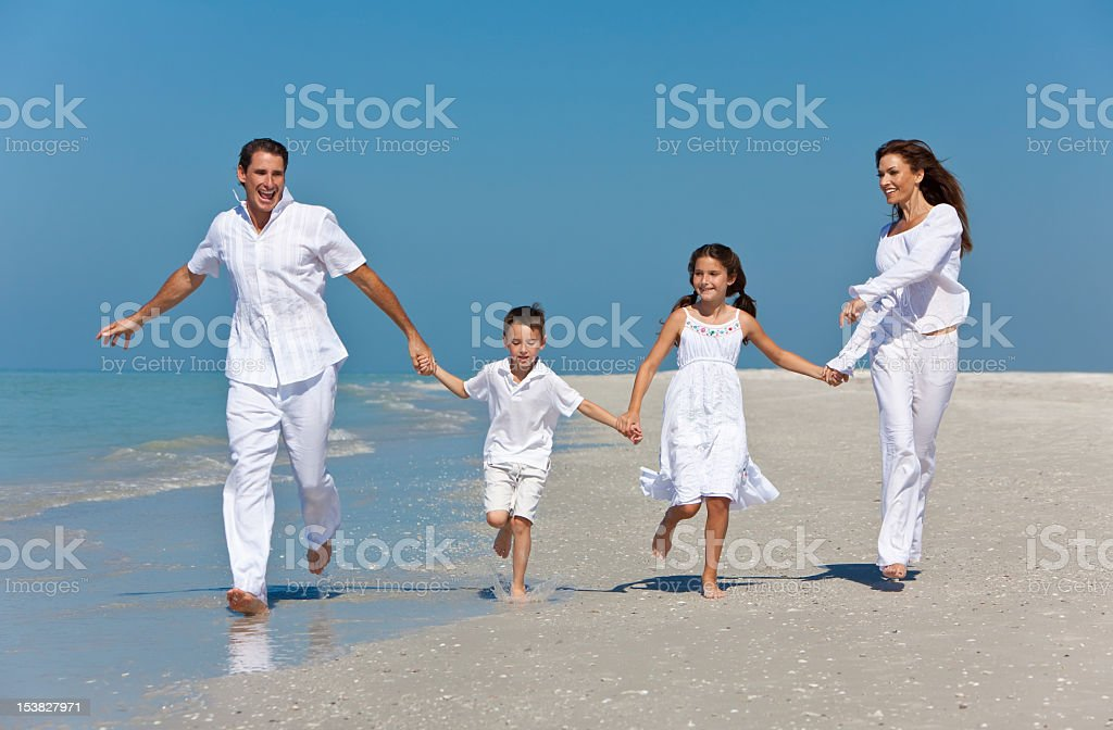 Mother, Father and Children Family Running Having Fun At Beach royalty-free stock photo