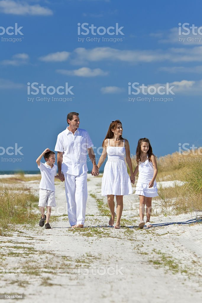Mother, Father and Children Family Walking On Beach royalty-free stock photo