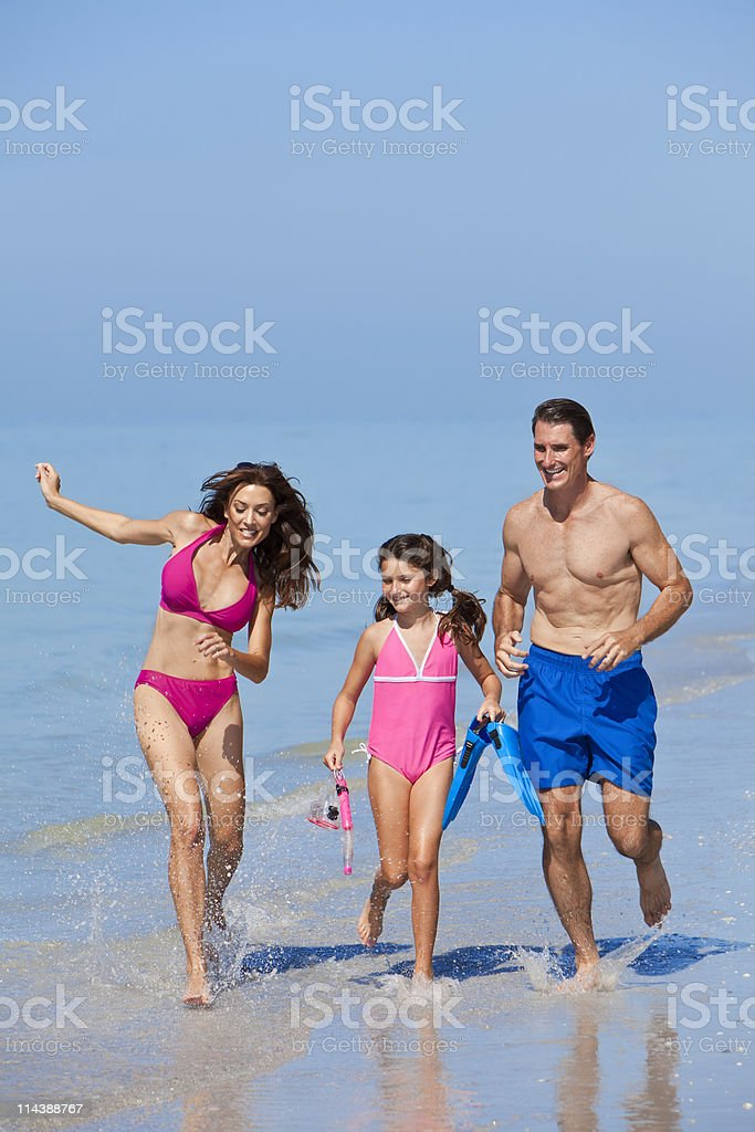 Mother, Father & Dahughter Child Family Running on Beach royalty-free stock photo
