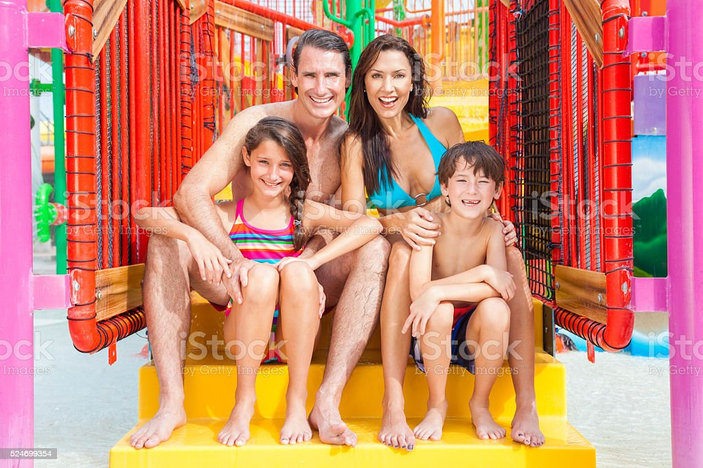 Mother Father Son Daughter Child Family at Water Park stock photo