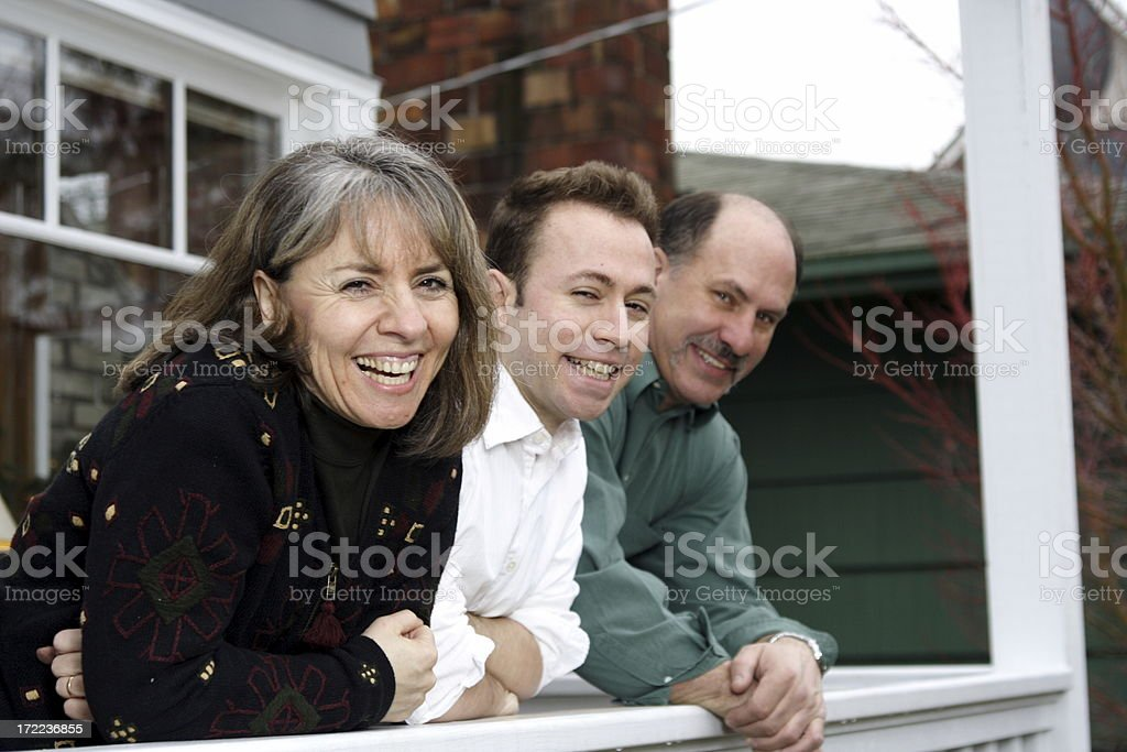 mother, father, son, in front of house royalty-free stock photo