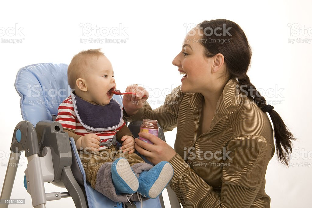 Mother feeding a bonny toddler. XXXL royalty-free stock photo