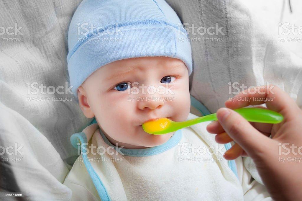 Mother feeding baby stock photo