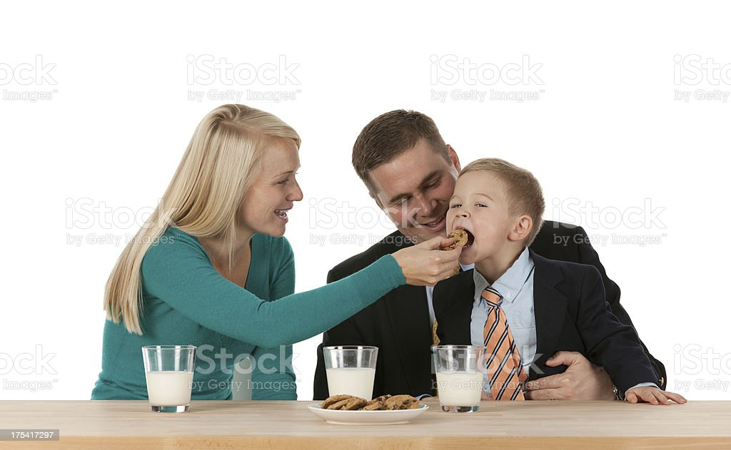 Mother feeding food to her son royalty-free stock photo