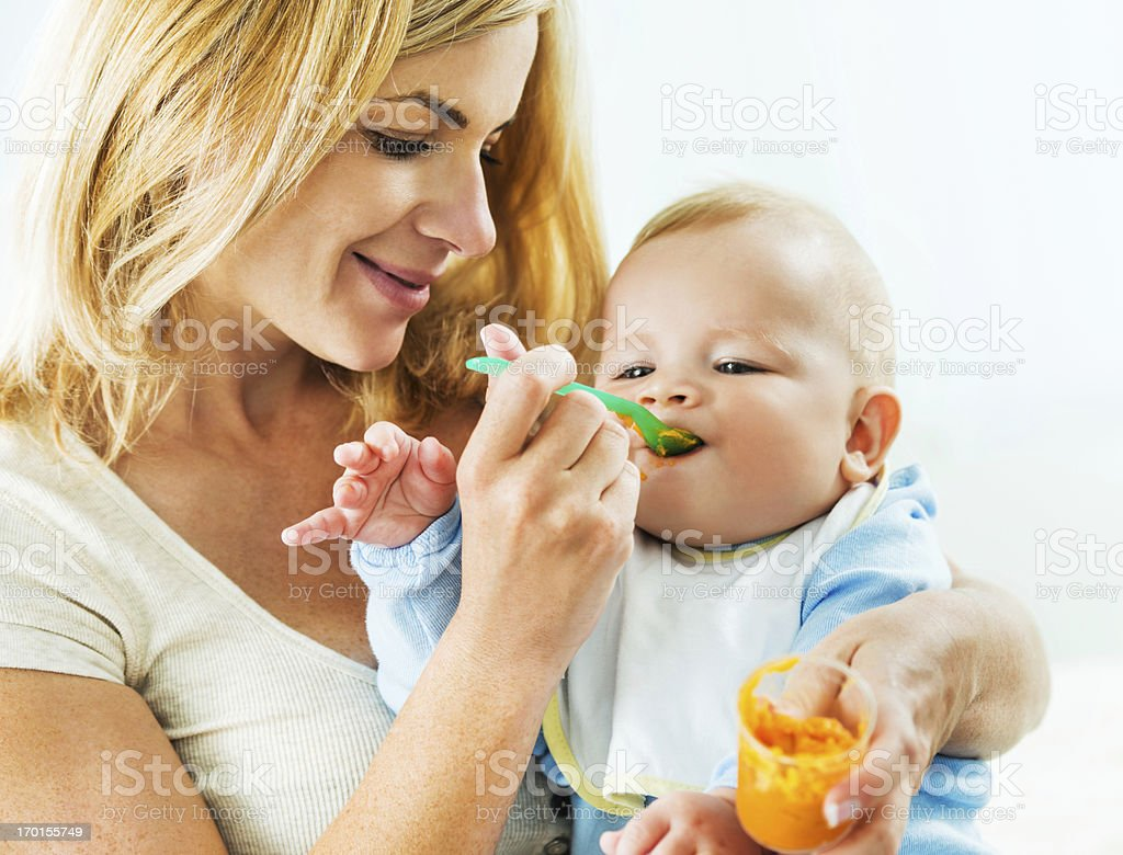 Mother feeding her baby. stock photo
