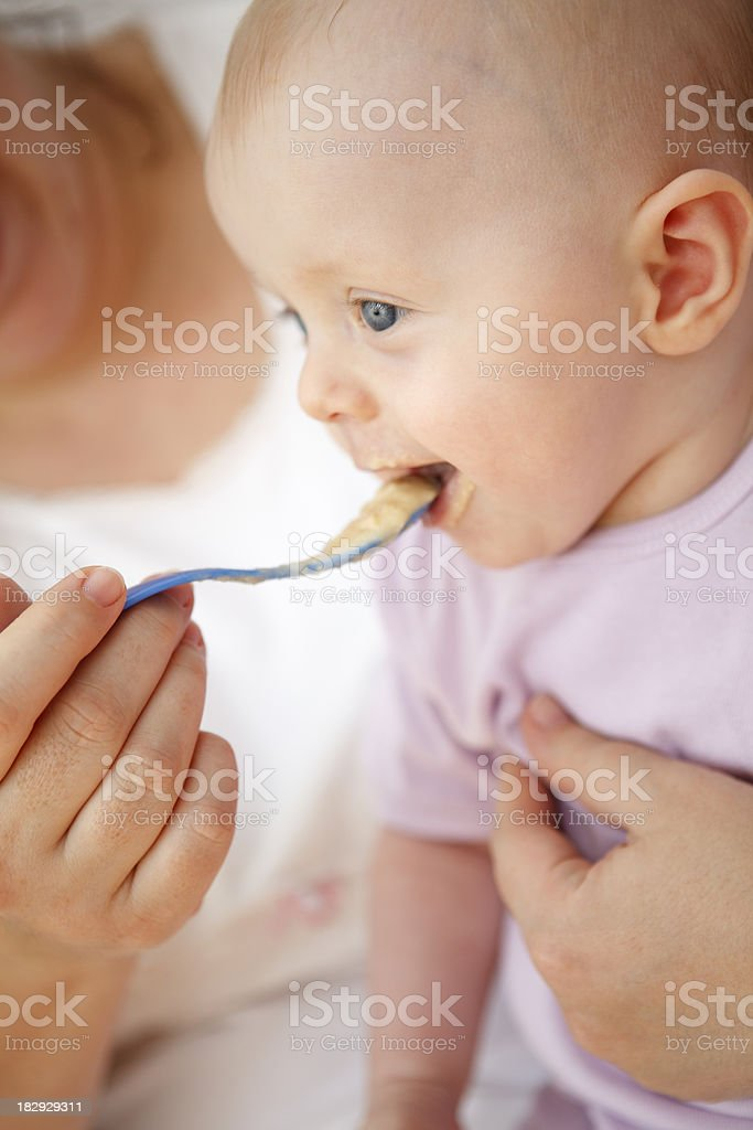 Mother feeding her baby royalty-free stock photo