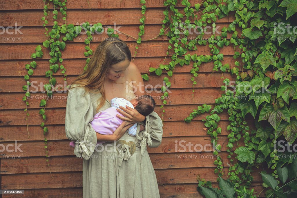 Mother feeding her baby stock photo