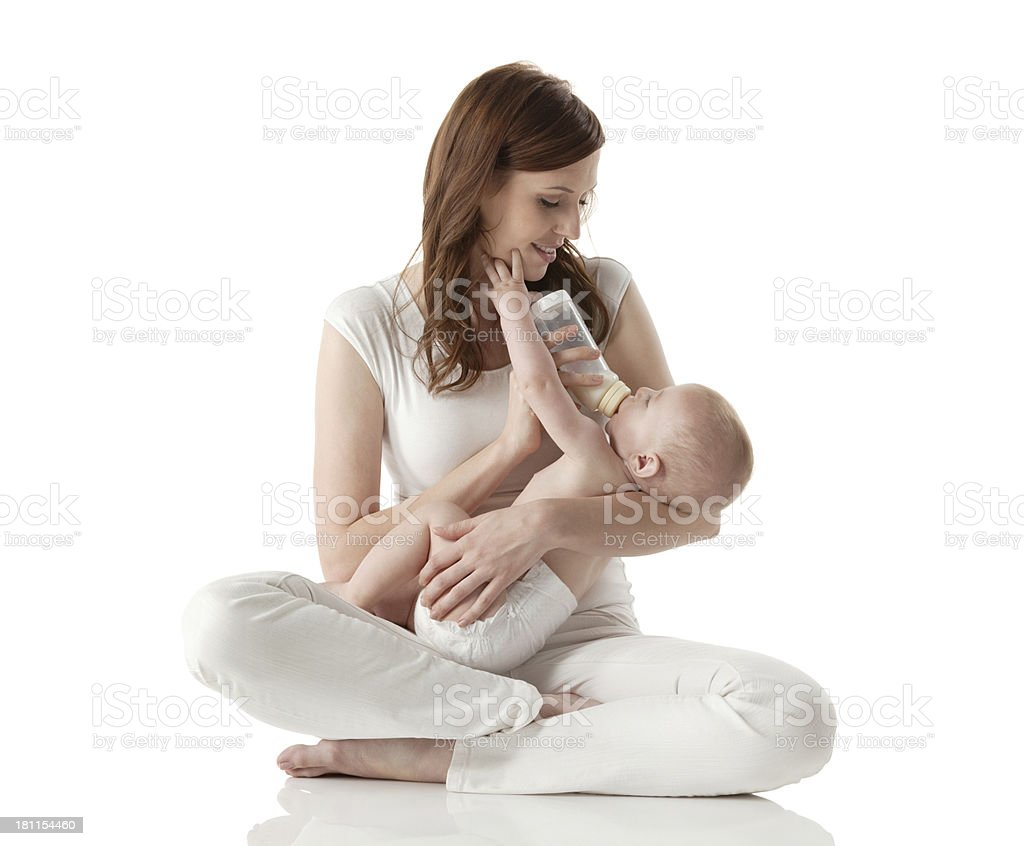 Mother feeding her baby with milk stock photo