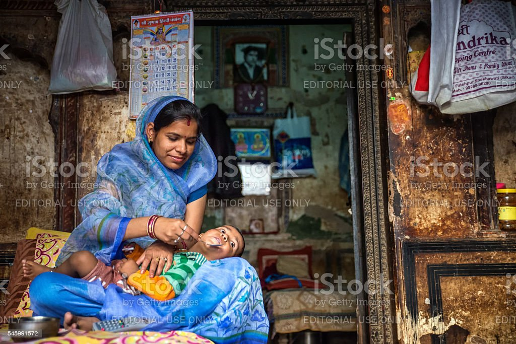 Mother feeding her child stock photo