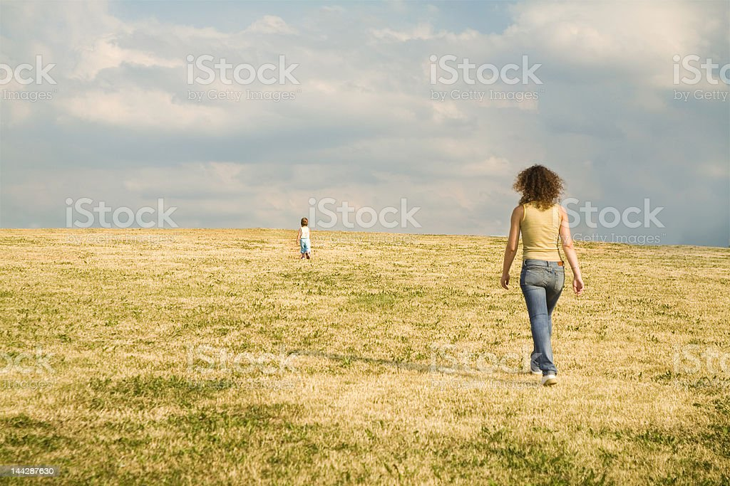 mother following child royalty-free stock photo