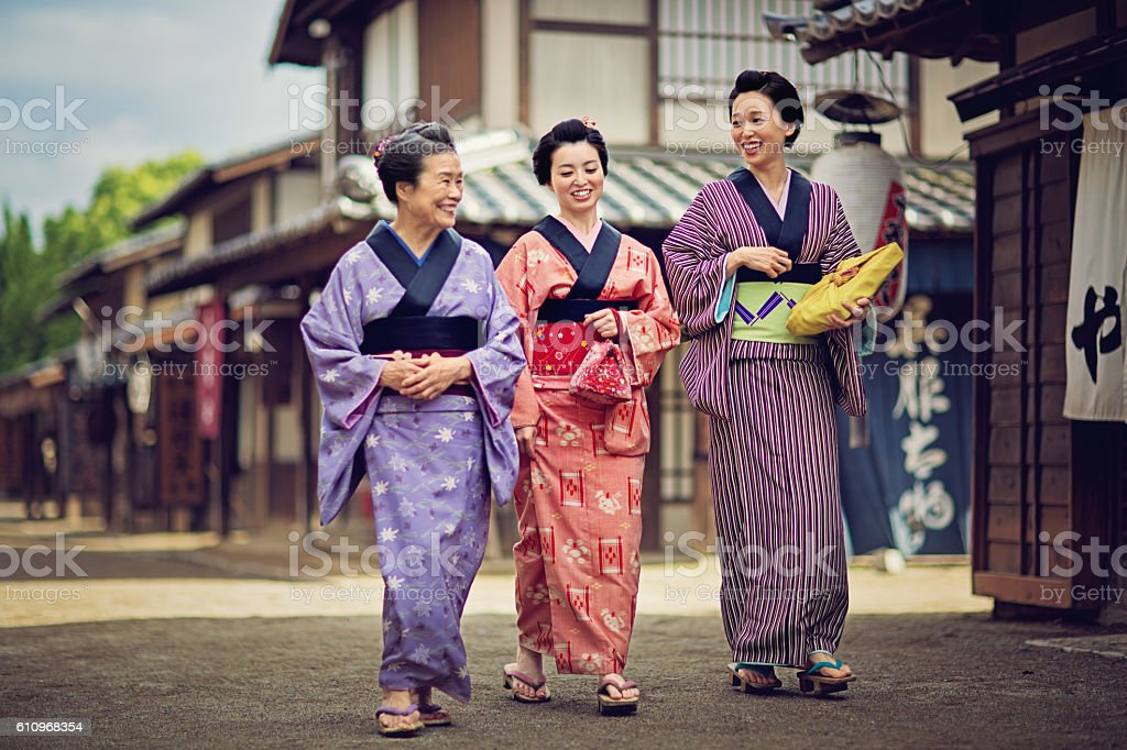 Mother from edo period is talking with her daughters. stock photo