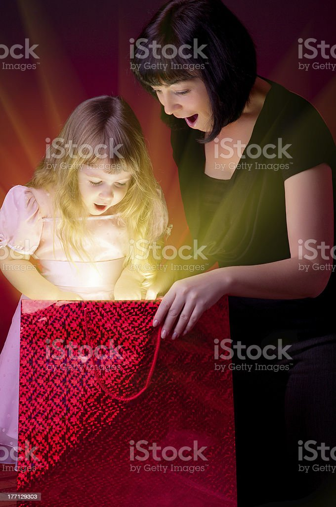 Mother give gift to her daughter royalty-free stock photo