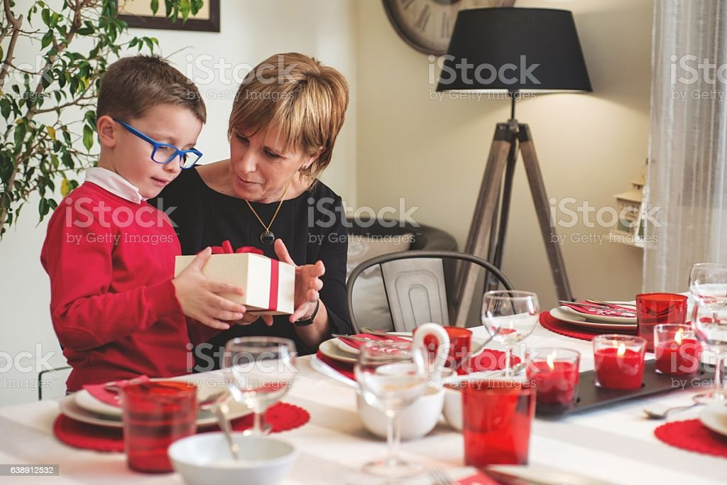 Mother Giving Gift to her Son stock photo