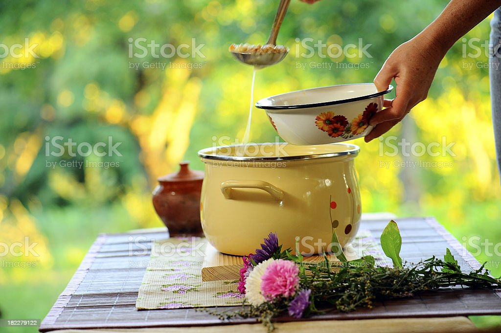 mother giving her daughter fresh soup royalty-free stock photo