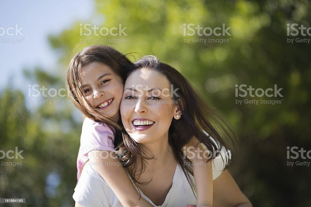 Mother Giving Piggyback Ride To Daughter royalty-free stock photo