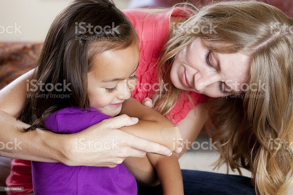 Mother Helping her Daughter royalty-free stock photo