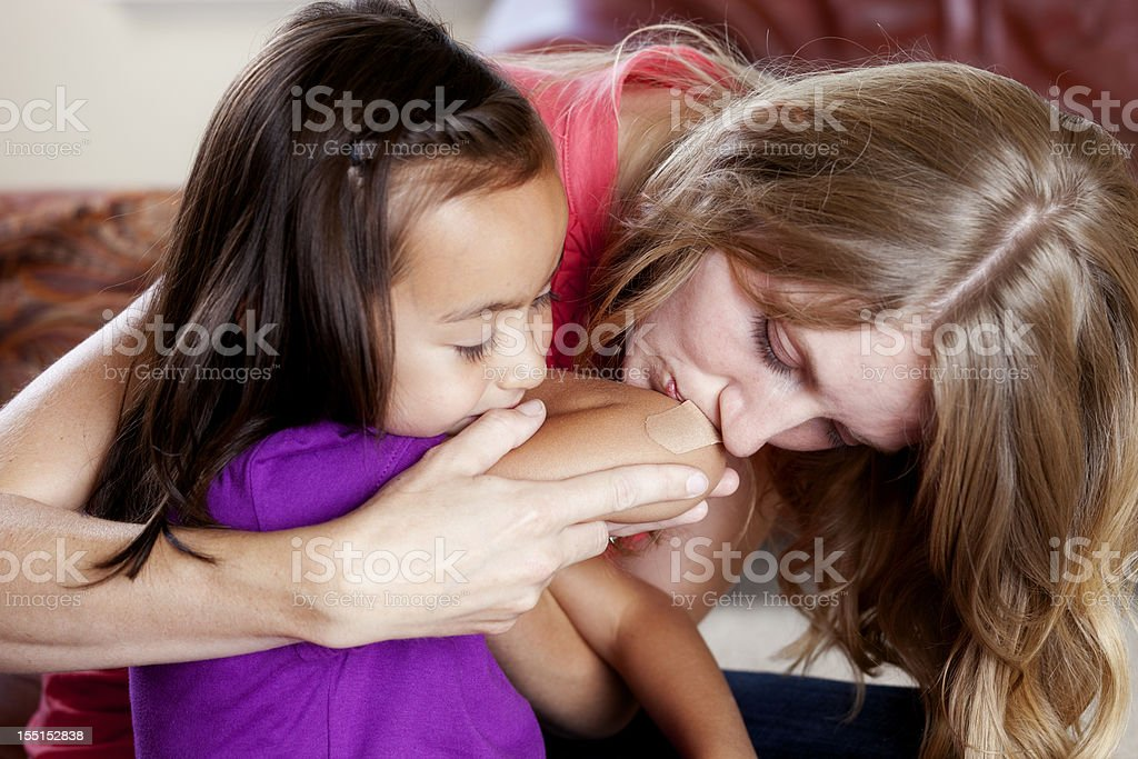Mother Helping her Daughter stock photo