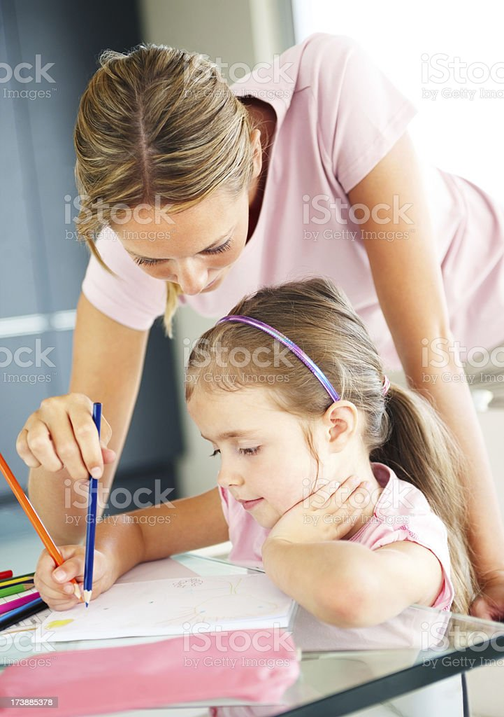 Mother helping her daughter with schoolwork royalty-free stock photo