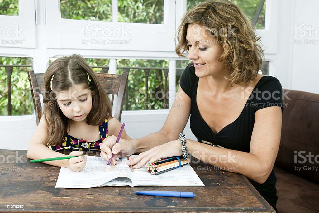 Mother helping her daugther with the homework royalty-free stock photo