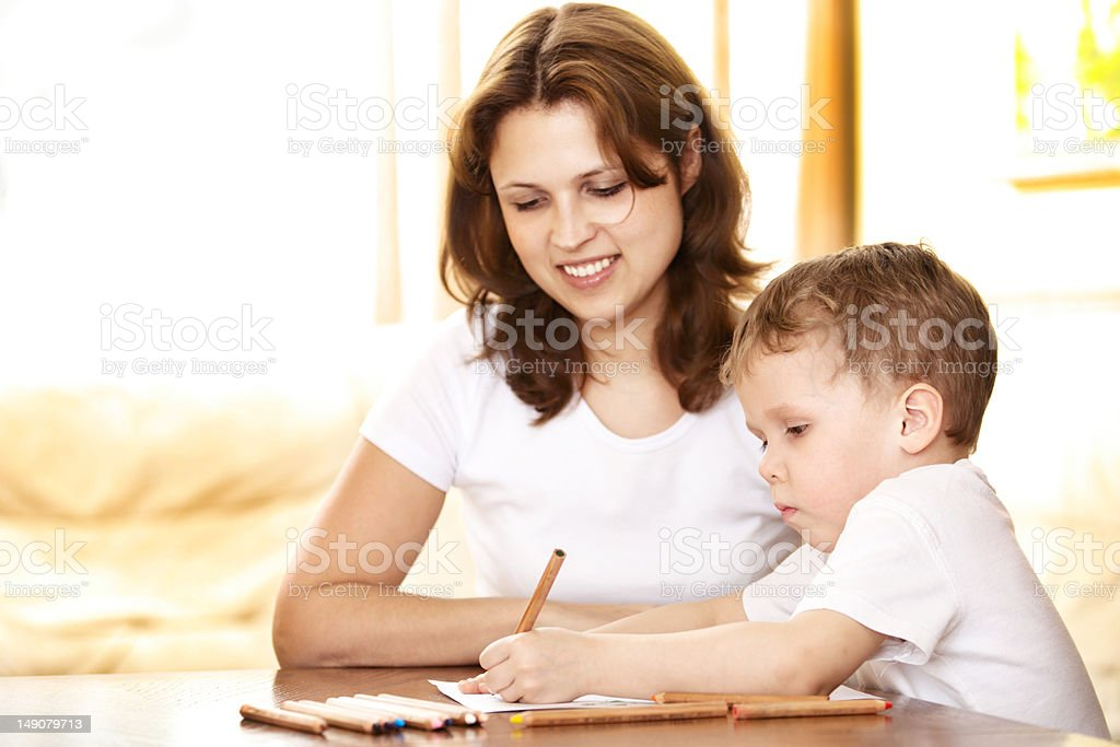 mother helping in homework to her son royalty-free stock photo