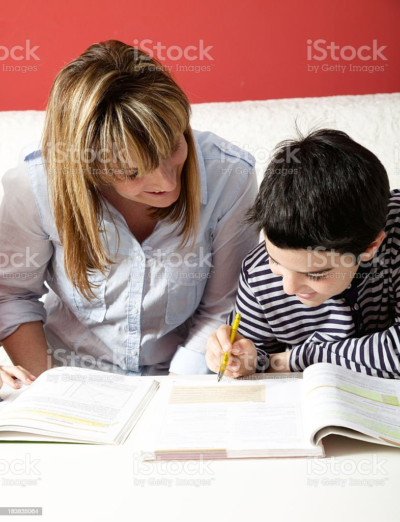 Mother helping son with his homework royalty-free stock photo