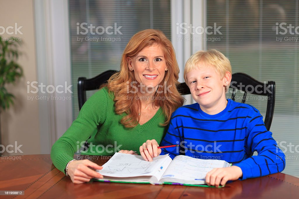 Mother helping son with homework royalty-free stock photo