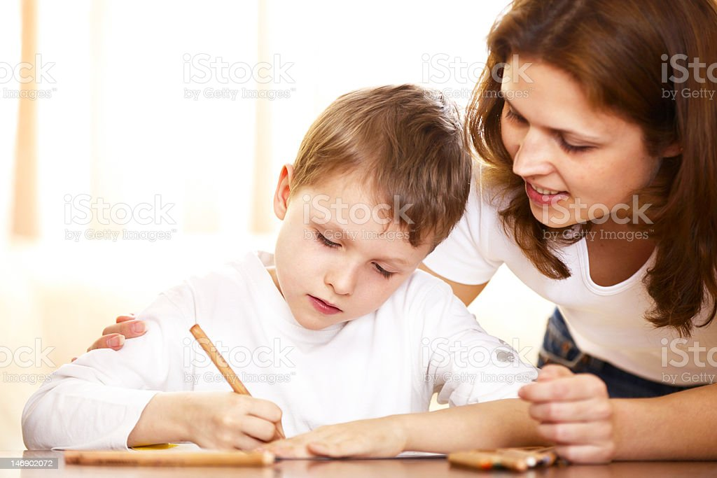 mother helping with homework to her son royalty-free stock photo
