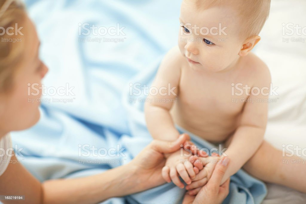Mother hodling hands with daughter stock photo