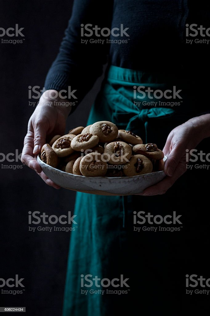 Mother holding a plate of cookies stock photo