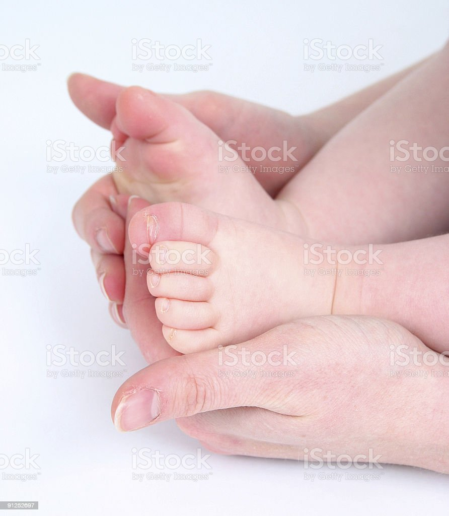 Mother holding babies feet royalty-free stock photo