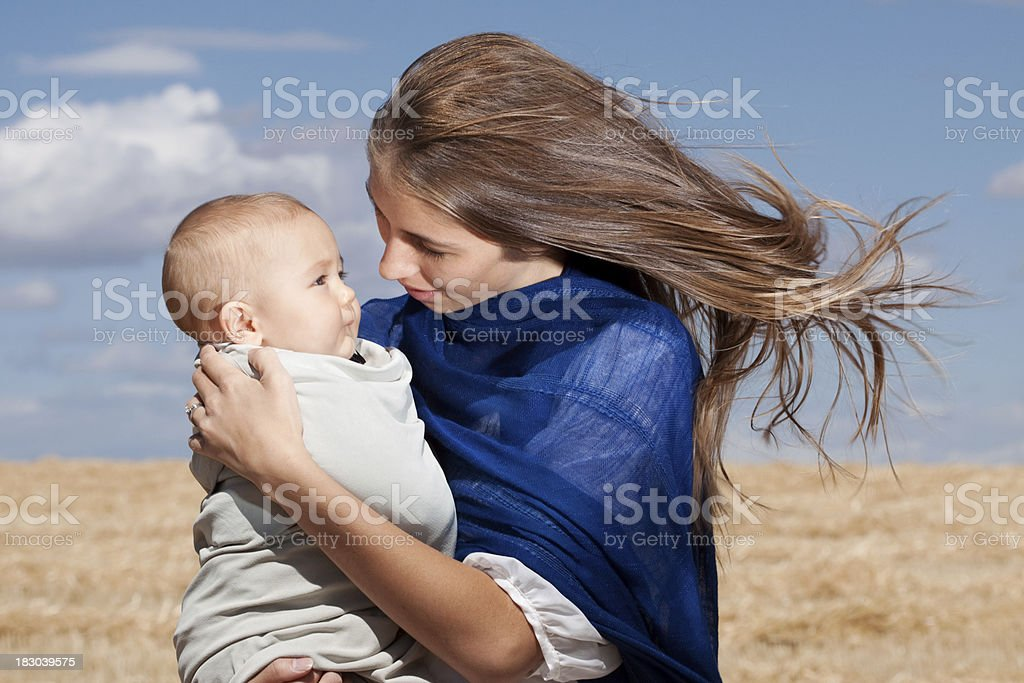 Mother Holding Baby Outdoors in Wind royalty-free stock photo