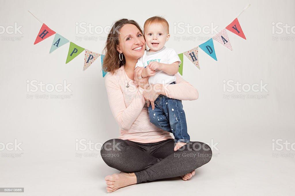 Mother Holding Birthday Baby stock photo