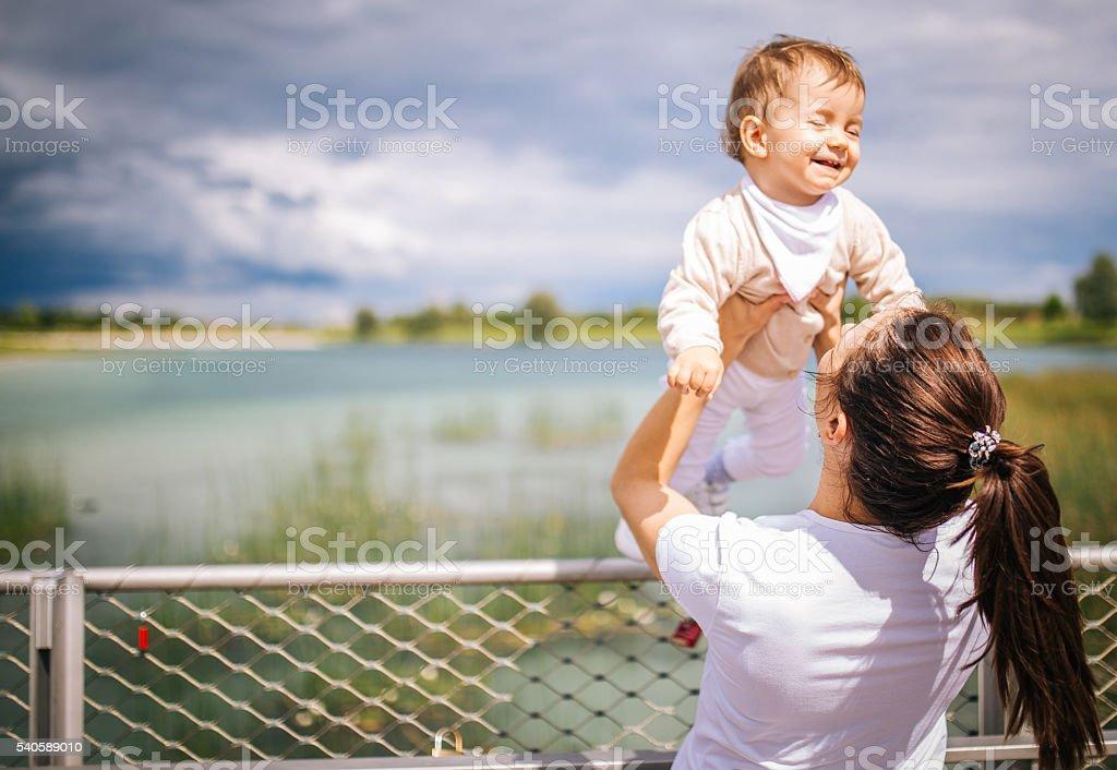 Mother holding child stock photo