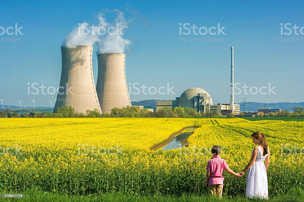 Mother Holding Hands with Son at Nuclear Power Station stock photo