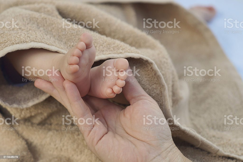Mother holding her child's feet stock photo